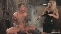 Dominatrix ties and gags her sex slave