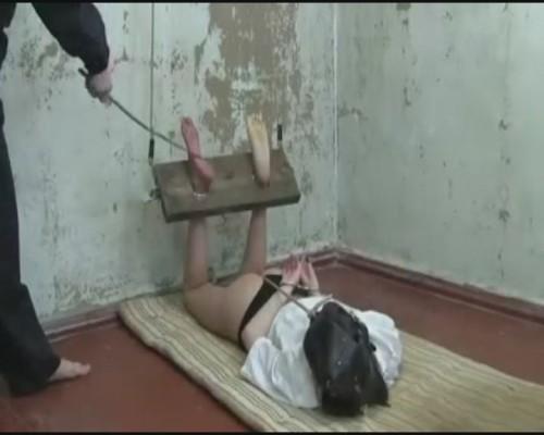 Bastinado with hard cane bounded girl